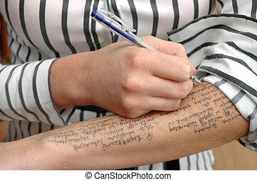 Student cheats - Student writes information on hand on exam