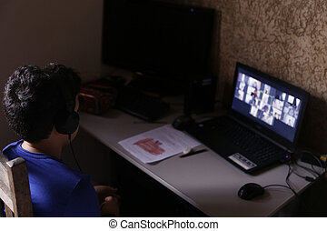 student child on computer in virtual class