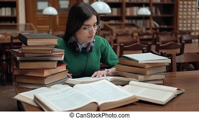 Student Collects Information - Bright student collecting...