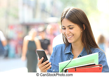 Student consulting online information in a phone