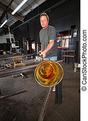 Student Cooling Off Glass Object - Man cooling off yellow...