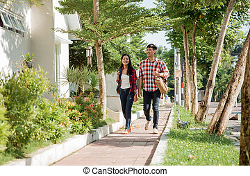 student couple walking together
