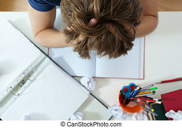 Student doing his homework - Tired student doing his...
