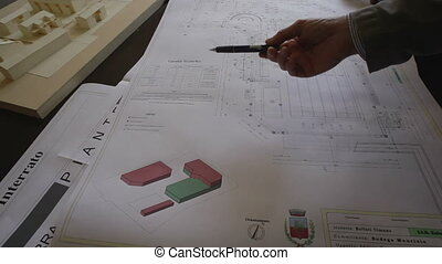 VIMERCATE, ITALY - APRIL, 24: Student presenting his project at teachers during the exam on April 24, 2013