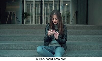 Student Female Friends Woman Lady Girl Photographing Phone, Make Selfie. Young Beautiful Student Business Female With Long Hair on the Background Building.