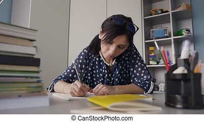 Student girl doing homework and preparing for exams, cute girl learning her lessons, student education, back to college or university