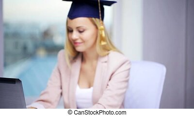 student girl in bachelor cap showing diploma