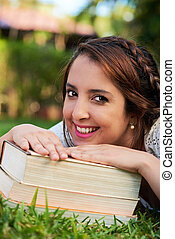 student girl lean on books