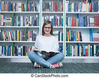 student, girl lezen, boek, in, bibliotheek