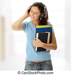 Student girl listening to the music