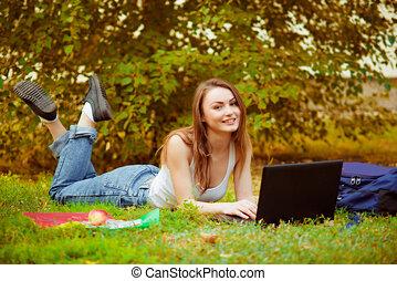 Student girl on green grass