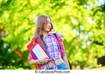 Student girl outdoors going back to school