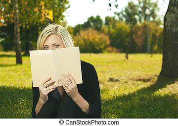 student girl reading in park