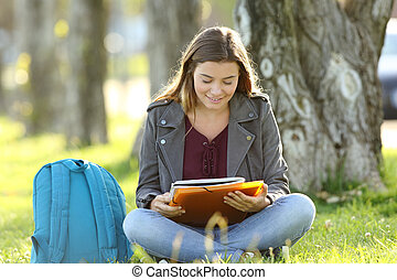 Student girl studying reading notes outdoors