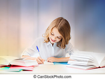 student girl with books writing in notebook