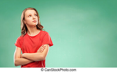 student girl with crossed arms over green