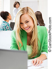 student girl with laptop in college