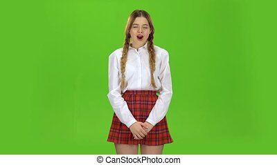 Student girl yawning. Green screen - Student girl dressed in...