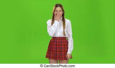 Student girl yawning. Green screen