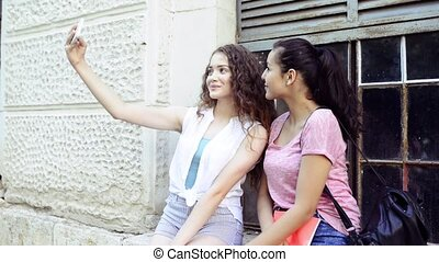 student girls in front of university taking selfie. -...