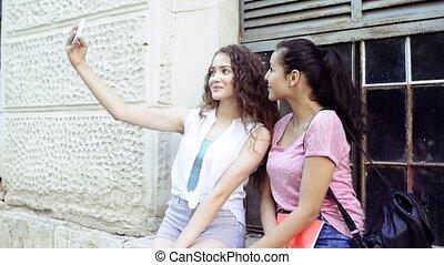 student girls in front of university taking selfie. -...