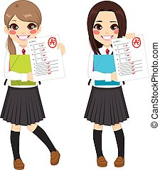 Student Girls Test Results - Young student girls showing...