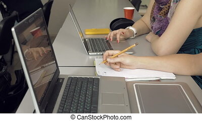 Student girls with their laptops computers