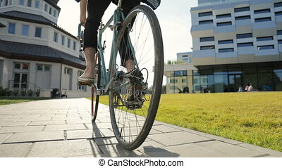 Student Goes Cycling - Man in light brown trainers going...
