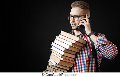 Student holding books and cellphone