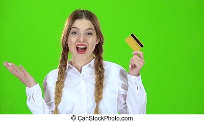 Student in a white blouse with a credit card is happy. Green screen