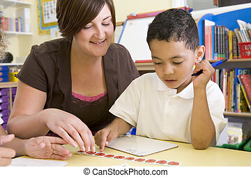 Student in class with teacher learning numbers