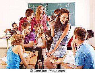 Student in classroom near blackboard. - Group student in ...
