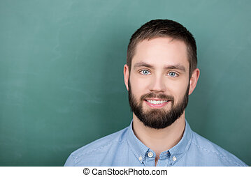 Student in front of a Chalkboard