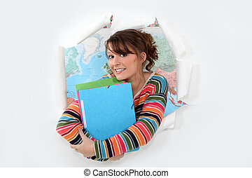 Student in front of a map