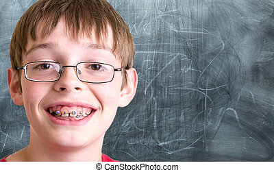 Student In front of Chalkboard