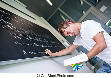Student  in front of the blackboard