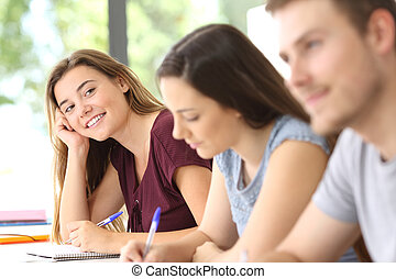 Student in love looking at a classmate - Student in love...
