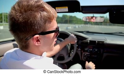 Student in sunglasses ride drive cabriolet by street