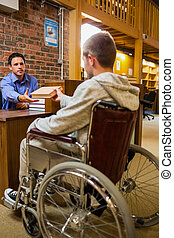 Student in wheelchair at the librar