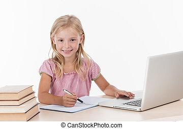 Student little school girl doing homework. cute girl using laptop computer on white background