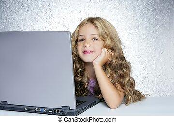Student little school girl on laptop compute