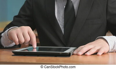 Student looking at photos using computer tablet