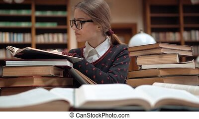 Student Looks for Information - Smart student looking for...