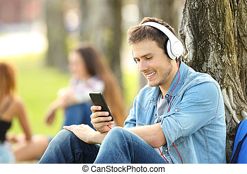 student, lytte, musik, hos, hovedtelefoner, ind, en, park