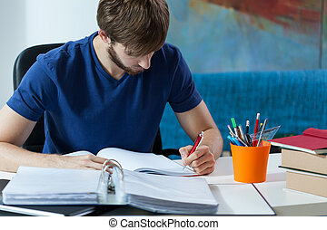 Student making notes - Attractive student making notes in...