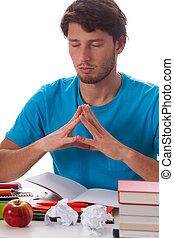 Student meditating before task on isolated background