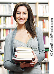 student, met, menigte van boeekt, in, de, bibliotheek