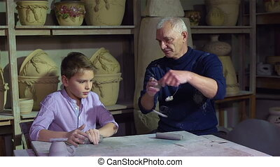 Student Of Artisan - Diligent pupil learning from a senior...