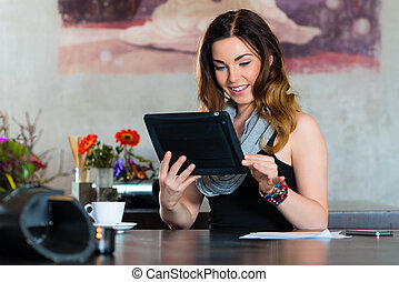 Student or businesswoman working in cafe - Young woman in a...
