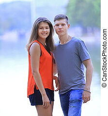 student pairs on blurred background of lake city